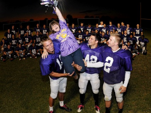 High School Football Players Protect Girl With Special Needs From Bullies